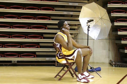 Ike Diogu does a phone interview between photo shoots in 2004 at Wells Fargo Arena.
