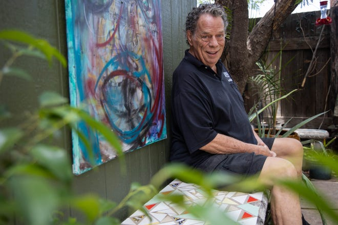 Kim Moody poses for a photo in the backyard of his home, Alwun House, in Downtown Phoenix on June 26, 2019.