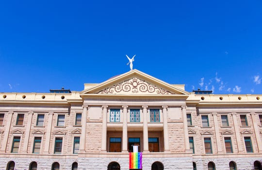 Arizona Secretary of State Katie Hobbs hung a gay pride flag on the balcony of the historic state Capitol building on June 28, 2019.
