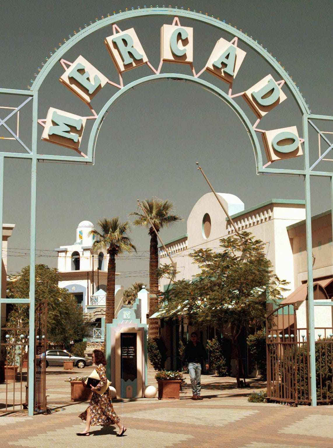 A woman walks past one of the entrances to the Mercado, a downtown shopping complex in Phoenix on Sept. 20, 1995.  Arizona Gov. Fife Symington  built the complex, which later figured into a bankruptcy and a federal investigation.