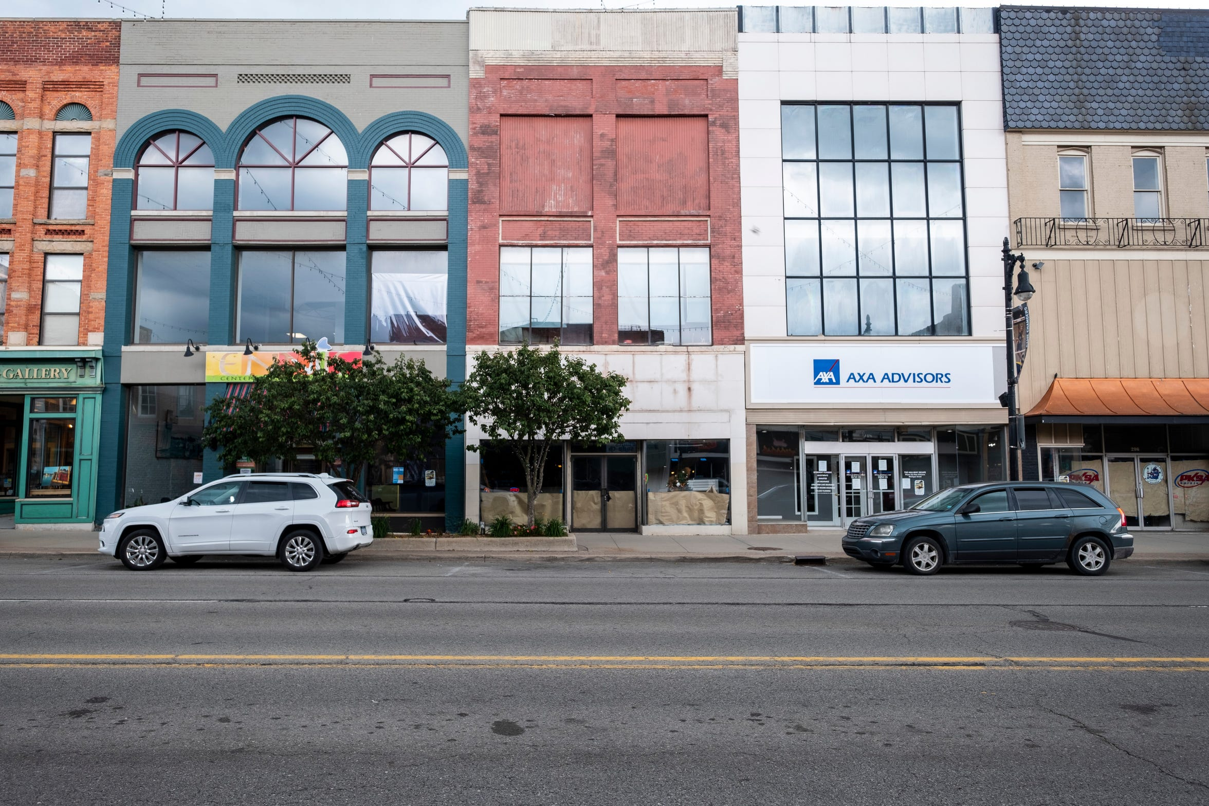 Even with more businesses moving downtown, several storefronts and buildings along Huron Avenue remain vacant.