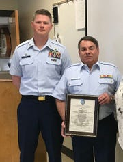 Daniel Collins, right, was recognized as an Honorary Chief in the U.S. Coast Guard Auxiliary for his work in the Auxiliary Food Service Program at the Port Huron Station.