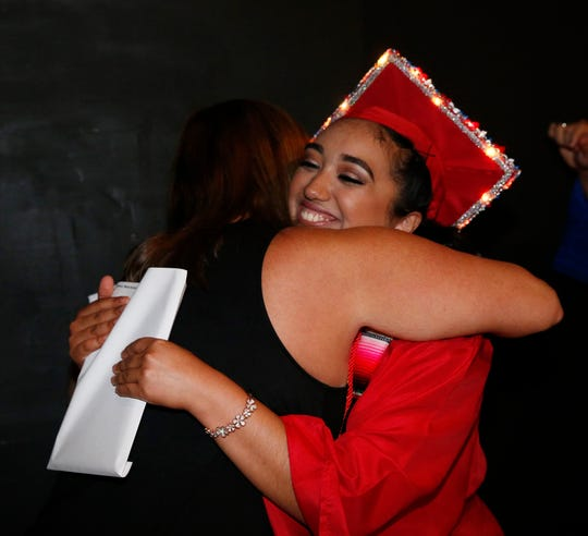 Maria Caltenco gives a hug to school counselor Suzanne deSimone after receiving her diploma during the Roy C. Ketcham High School graduation at the Majed J. Nesheiwat Convention Center in the City of Poughkeepsie on June 27, 2019.