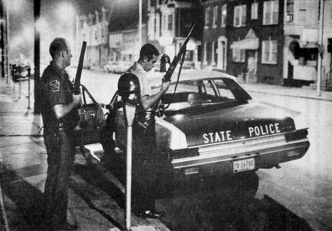 Police officers stand guard on Market Street in downtown York one night in the summer of 1969.