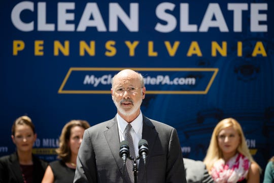 "Pennsylvania Gov. Tom Wolf speaks during a news conference in Harrisburg, Pa., Friday, June 28, 2019. Lower level criminal convictions are starting to be automatically sealed under a year-old Pennsylvania state law touted as a way to give offenders a fresh start. State officials and other supporters touted the new phase of the ""clean slate"" legislation Friday in Harrisburg, calling the program a model for other states. (AP Photo/Matt Rourke)"