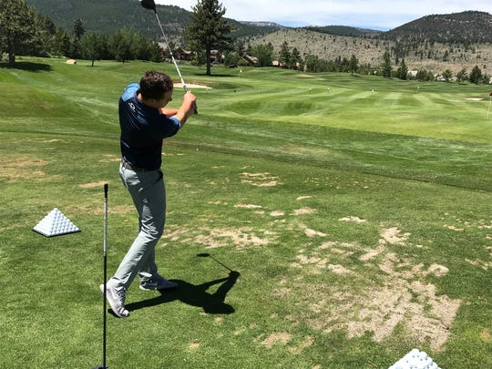Andrew Putnam, the defending champion in the PGA Tour Barracuda Championship, hits a ball Tuesday at Montrêux Golf and Country Club in Reno.