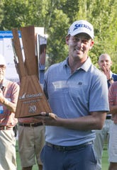 Andrew Putnam holds the championship trophy for winning the Barracuda Golf Championship at Montreux on Aug. 5, 2018.