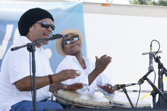Edgardo Martinez and Enrique Esalera perform with the BombaRoc group during the 48th Annual Puerto Rican festival at the Frontier Field VIP Parking Lotin 2017.