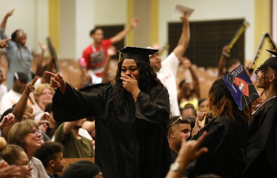 Families cheer on graduates during Vanguard Collegiate High School's Class of 2019 Commencement, Thursday evening.