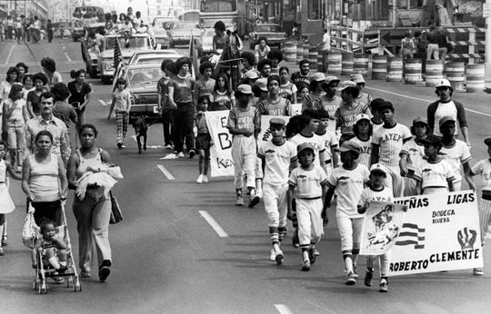 Young baseball players participate in the parade kicking off the 1976 Puerto Rican Festival.