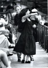 Leonoardo Orlando twirls Adriana Ortiz to the music of Bomplene at the Puerto Rican Festival July 1988.