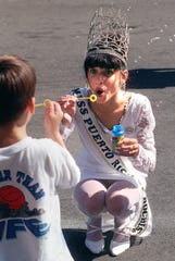 Ismari Martinez,17, Miss Puerto Rico of Rochester, has a bubble blowing duel with Oswaldo Mercado,5, of Rochester, during the 1996 Puerto Rican Festival at Brown's Race. A group of kids were blowing bubbles and she joined in on the fun. She was elected in July and said this is the biggest event of her year long activities as Miss Puerto Rico of Rochester.