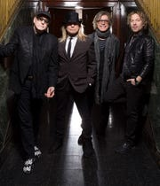 Members of the band Cheap Trick, left to right: Guitarist Rick Nielsen, lead singer Robin Zander, bassist Tom Petersson and Rick's son, drummer Daxx Nielsen.