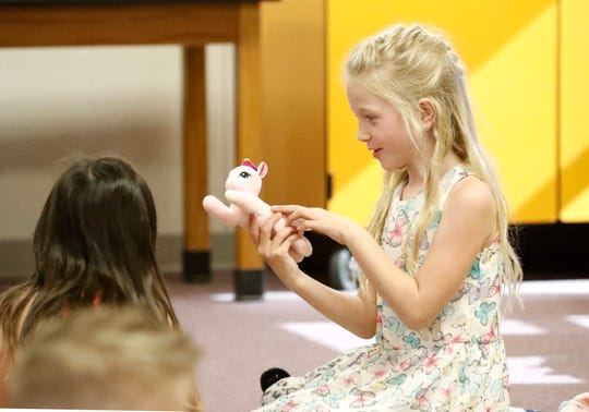 Rhylee Gardner holds a stuffed animal during Camp Noah at Grant School on Friday, June 28, 2019.