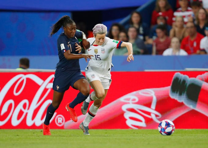 Jun 28, 2019; Paris, FRANCE; United States forward Megan Rapinoe (15) chases the ball with France forward Kadidiatou Diani (11) in the second half of a quarterfinal match in the FIFA Women's World Cup France 2019 at Parc des Princes. Mandatory Credit: Michael Chow-USA TODAY Sports