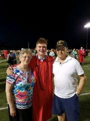 Ginne Mistal and Al Mistal are pictured with their grandson, Garret Cook.