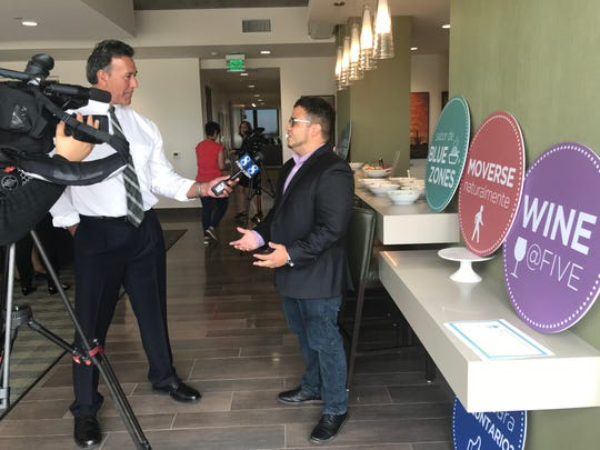 A reporter interviewing a Fort Worth Blue Zones Engagement Director Ricky Cotto. June 28, 2019.