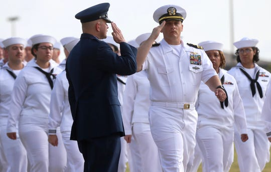 A member of the armed forces salutes Colonel Andres Nazario, left, after he assumed command of the 17th Training Wing at a ceremony at Goodfellow Air Force Base on Friday, June 28, 2019.