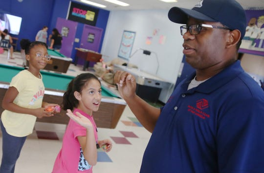 Sam Singleton gets a high five at the Boys and Girls Club in San Angelo on Thursday, June 27, 2019.