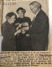 Two San Angelo city employees in 1955 are awarded for their 43 years of service. Micaela Rogers (left) was secretary for the Board of City Development and Mamie Barfield was the city secretary and tax assessor-collector. They are receiving honors from M.D. Bryant, former mayor of San Angelo.