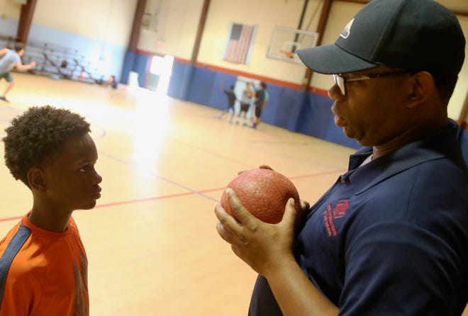 Sam Singleton, right, talks to his nephew, A'niaus Anderson, left, at the Boys and Girls Club in San Angelo on Thursday, June 27, 2019.