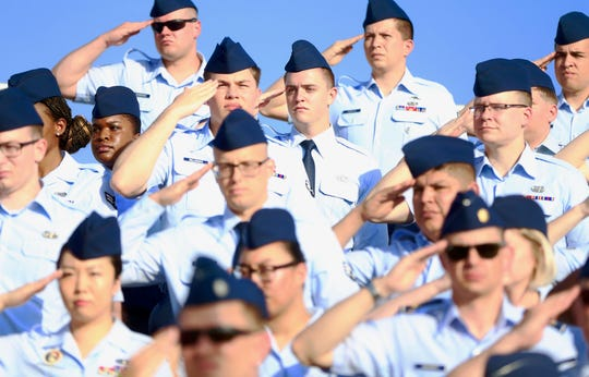 Military personnel salute during a change of command ceremony at Goodfellow Air Force Base on Friday, June 28, 2019.