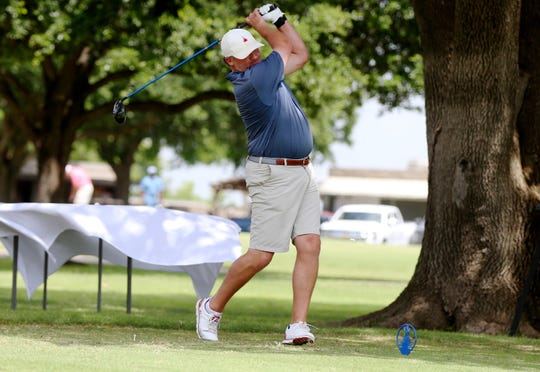 Zach Drennan drives the ball off the tee during the first round of the 2019 San Angelo Country Club Men's Partnership on Thursday, June 27, 2019.