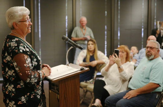 Cathy DeLaughter, left, addresses the audience at a San Angelo Police Department retirement ceremony honoring her and another officer's service at McNease Convention Center on Friday, June 28, 2019.