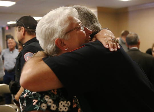 Cathy DeLaughter shares an embrace with a former colleague with the San Angelo Police Department at a retirement ceremony for her and Michael Peterson (not shown) at McNease Convention Center on Friday, June 28, 2019.