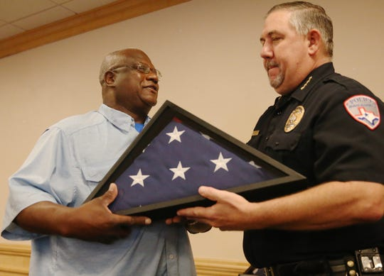 Michael Peterson, left, accepts a commendation honoring his service as a  San Angelo police officer from chief of police Frank Carter, right, during a ceremony at McNease Convention Center on Friday, June 28, 2019.