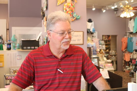 Steve Frene checks his computer at the front counter on June 28, 2019. Frene and his wife Debbie own Victorian Charm in Berlin.