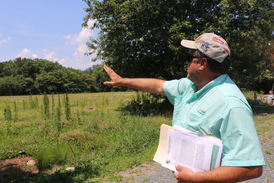 Spiro Buas describes the boundaries of his property on June 28, 2019 in Berlin. Buas is the property owner of six parcels at the corner of Main Street and Route 50 in Berlin.