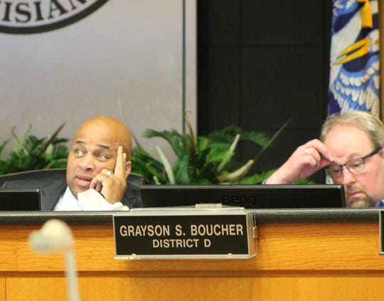 Councilmen Jerry Bowman and Grayson Boucher at a City Council meeting.