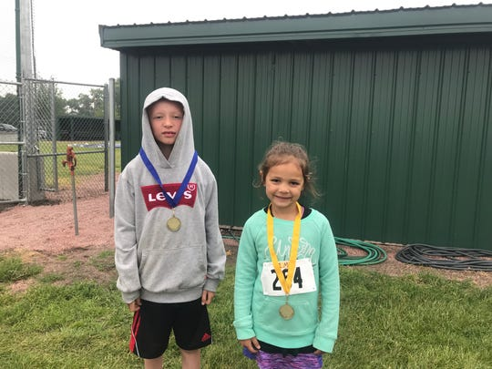 Competing in the 1 Mile race was Thomas Christensen (left) of Baltic, age 8, and Maebry Dybedahl of Dell Rapids, age 5.