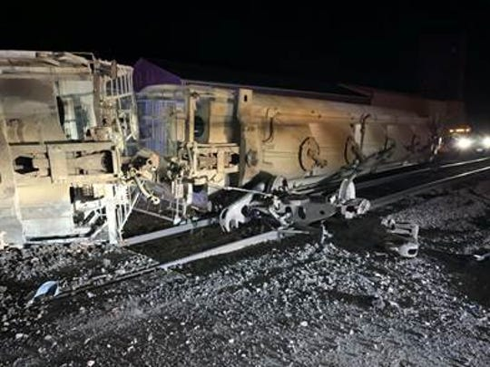 About four empty rail cars piled up along South A Avenue in New Underwood in front of the grain elevator, according to authorities.