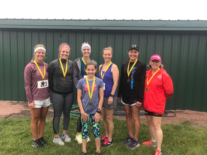 Women's winners by age group (left-to-right): Shaylee Hoff of Dell Rapids, 16-19, 21:03; Corynn Hoff of Sioux Falls, 20-29, 25:56; Amanda McMillan of Dell Rapids, 30-39, 22:14; Jessica Holt of Renner, 40-49, 24:48; Lisa Schroeder of Dell Rapids, 50-59, 25:52; Debra Shissler of Dell Rapids, 60-plus, 25:10. Front: Lucy Vargas of Dell Rapids, 15-Under, 25:39.