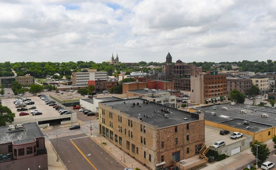 The iconic cathedral and courthouse are visible from the West-facing apartments on the 13th floor of River Tower Apartments on Friday, June 28, in Sioux Falls.