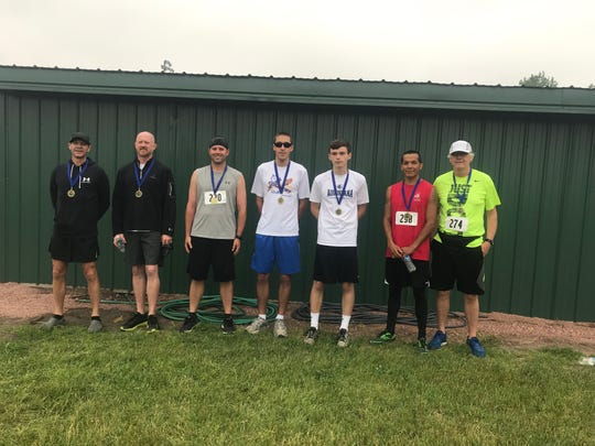 Men's winners by age group (left-to-right): Kevin Streff of Madison, 50-59, 20:30; Todd Christensen of Baltic, 40-49, 20:37; Jesse Kroupa of Kimball, 30-39, 20:03; John Ditter of Baltic, 16-19, 20:16; Seth Roemen of Dell Rapids, 15-Under, 21:59; Jared Weston of Brookings, 20-29, 18:17; David Weelborg of Brookings, 60-plus, 30:53.