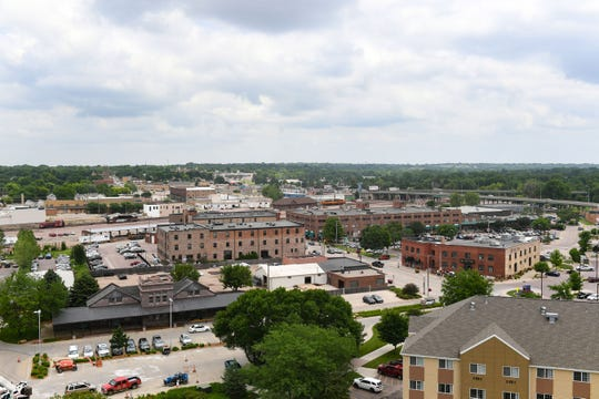 The view stretches beyond downtown from the East-facing apartments on the 13th floor of River Tower Apartments on Friday, June 28, in Sioux Falls.