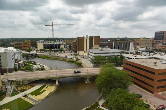 Construction on the new parking garage downtown and a bend in the Big Sioux River are visible from the South-facing 13th floor apartments of River Tower Apartments on Friday, June 28, in Sioux Falls.