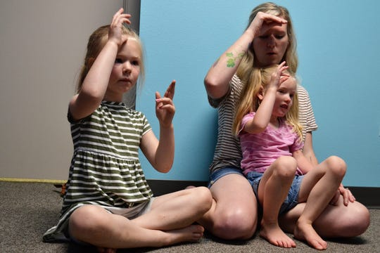 Parent Kamie Wittrock (right) uses sign language with her children Ivy and Iris Wittrock on Thursday, June 27, 2019, at Bloom, an indoor playground and child development center in Sioux Falls. Bloom started the sign language class this month for young children as a way to help them find their voice and connect with others regardless of how they communicate.