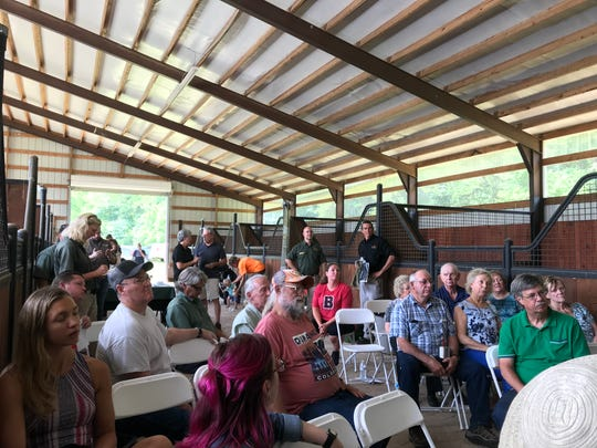 Visitors on Thursday, June 27, 2019, heard about the future of Ozark Mountain State Park during a meeting inside a 14-stall horse barn, which will be part of the new park.