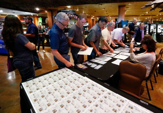 Customers line up to be some of the first people to buy the 2019-2020 Federal and Junior Duck Stamps at Bass Pro Shops in Springfield, Mo. on Friday, June 28, 2019.
