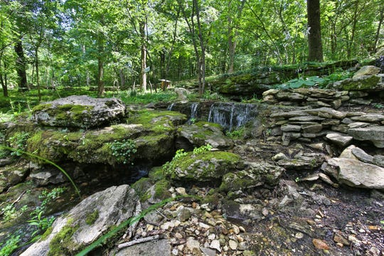 There are several outdoor living areas on the McKays' property. Colleen says a swinging chair near the waterfall is her favorite spot in the entire garden.