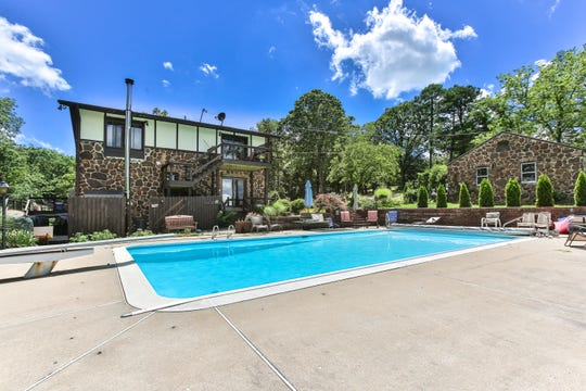 The McKays also have a large swimming pool at their disposal. Beyond the garage at right is the caretaker's cottage, which Colleen hopes to transform into guest quarters.