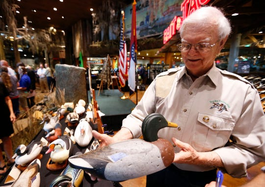 Nixa artist Don Brown shows off one of his wooden decoy ducks during a reveal of the 2019-2020 Federal Duck Stamp and Junior Duck Stamp at Bass Pro Shops in Springfield, Mo., on Friday, June 28, 2019.