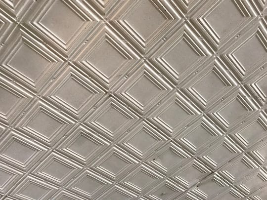 The ceiling at Missouri Rug Cleaners is made of pressed metal.