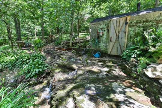 The springhouse remains in use, primarily as a spot to grow mushrooms.