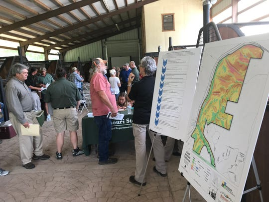 Visitors could view maps of Ozark Mountain State Park during Thursday's meeting.