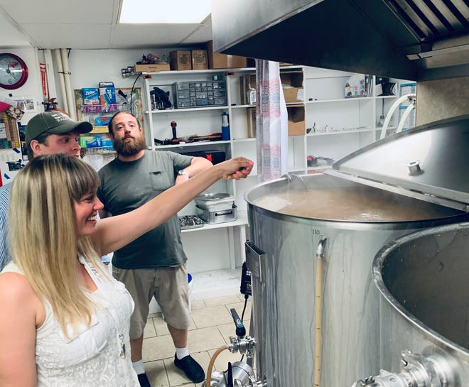 Redbeard Brewing Company owner Jonathan Wright with Jessica Goode, general manager of BLU Point Seafood Co. and Matt Hull, chef of BLU Point Seafood Co. brewing beer for an upcoming pop-up restaurant event.